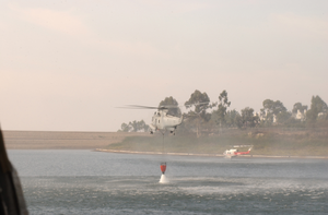 A Sea King Helicopter (uh-3h) Assigned To The Golden Gators Of Reserve Helicopter Combat Support Squadron Eighty Five (hc-85) Loads Bambi Buckets To Conduct Water Drops On Brush Fires In Support Of Fire Fighting Efforts Image