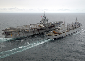 The Fast Combat Support Ship, Uss Detroit (aoe-4) Steams Alongside Uss Enterprise (cvn 65) While Conducting An Early Morning Replenishment At Sea (ras) Image