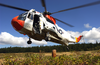 A Uh-3h Sea King Helicopter Assigned To Fleet Logistics Search And Rescue Team, Naval Air Station Whidbey Island, Conducts Hovering Exercises During A Training Flight Image