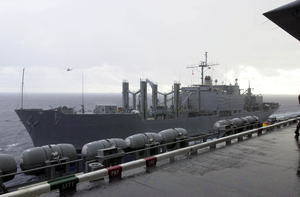 The Military Sealift Command Combat Stores Ship Usns San Jose (t-afs 7) Pulls Alongside Uss Nimitz (cvn 68) For A Routine Vertical Replenishment (vertrep). Image