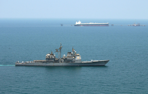 Uss Chosin (cg 65) Enforces An Exclusionary Perimeter As Commercial Oil Tanker Abqaiq Readies Itself To Receive Oil At Mina-al-bkar Oil Terminal (mabot), An Off Shore Iraqi Oil Installation Image