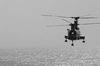 A Ch-46  Sea Knight  Helicopter Carries Supplies To The Mobile Bay During A Replenishment At Sea (ras) With The Uss Camden (aoe 2). Image