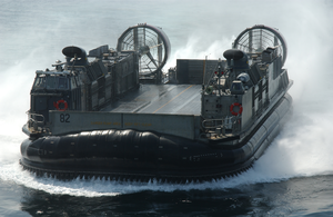A Landing Craft Air Cushion (lcac) Assigned To Assault Craft Unit Five (acu-5) From Camp Pendleton, Calif., Enters The Well Deck Of The Amphibious Assault Ship Uss Peleliu (lha 5) Image