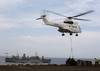 Sa-332 Super Puma Helicopters From Military Sealift Command Combat Stores Ship Usns Spica (t-afs 9) Delivers Pallets Of Supplies To Uss Kearsarge (lhd 3) Image