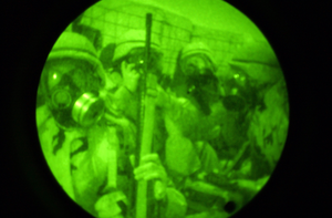 Navy Seabees Assigned To Naval Mobile Construction Battalion One Thirty Three (nmcb-133) Practice Donning Chemical Protective Suites And Mcu-2p Gas Masks During A Chemical, Biological, And Radiological Training Exercise In Kuwait. Image