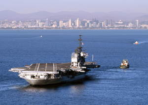 A Tugboat Tows The Decommissioned Aircraft Carrier Midway Into San Diego Bay. Image