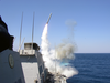 The Guided Missile Destroyer Uss Porter (ddg 78) Launches A Tomahawk Land Attack Missile (tlam) Toward Iraq During The Initial Stages Of Shock And Awe Image
