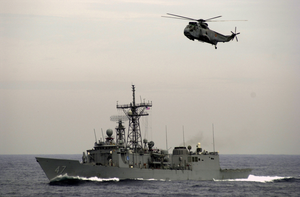 The Guided Missile Frigate Uss Nicholas (ffg 47) And A Helicopter From The Spanish Frigate Sps Navarra (f-85) Track A Simulated Cargo Vessel. Image