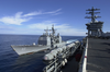 Uss Princeton (cg 59) Pulls Alongside Nimitz And Prepares To Receive Lines For A Replenishment At Sea (ras) Image