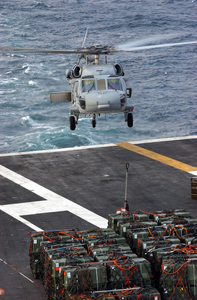 An Sh-60 Seahawk Helicopter Prepares To Transport Ordnance From Uss Theodore Roosevelt (cvn 71) To Uss George Washington (cvn 73). Image