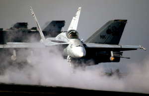 An F/a-18c Hornet Prepares To Launch From The Flight Deck Aboard Uss Abraham Lincoln (cvn 72). Image