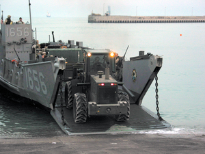 U.s. Army Personnel Assigned To The 567th Transportation Company Offload Water And General Military Supplies From A U.s. Navy Landing Craft Utility (lcu) Image