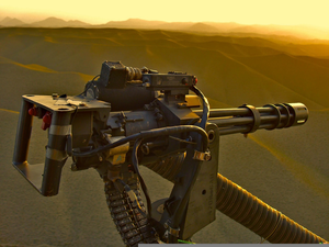 Minigun Firing Wallpaper Image