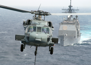An Mh-60s Nighthawk Delivers A Palette Of Cargo To The Flight Deck Aboard Uss Enterprise (cvn 65). Image