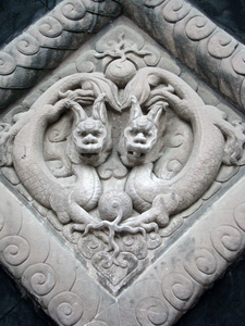 Carved Dual Dragons On Stone Wall Image