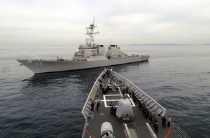 The Guided Missile Destroyer Uss John S. Mccain (ddg 56) Closes In On The Bow Of The Guided Missile Cruiser Uss Vincennes (cg 49), Commencing A Towing Exercise. Image