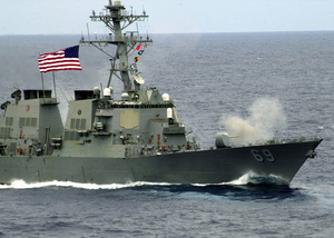 The Arleigh Burke-class Destroyer Uss Milius (ddg 69) Fires Its 54-caliber (mk 45) Lightweight Gun. Image