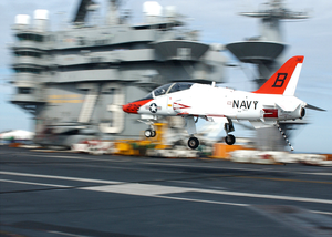 A T-45a Goshawk Makes A Final Approach With Tail Hook Down During An Arrested Landing Image