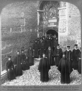 Pious Monks Of The Eastern Orthodox Church At Door Of Monastery, Megaspelaeon, Greece Image