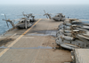 A Wash Down For Deployed Helicopters As Well As The Flight Deck Is In Order After The Amphibious Assault Ship Uss Kearsarge Image
