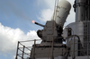 The Guided Missile Cruiser Uss Vincennes (cg 49) Fires A Close In Weapons System (ciws) While Under Way In The Pacific Ocean. Image