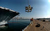 A Retired E-2 Hawkeye Is Hoisted Aboard The Decomissioned Aircraft Carrier Midway At Naval Air Station North Island, Calif. Image