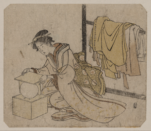 Young Lady Removing A Kemari (ball) From Its Box. Image