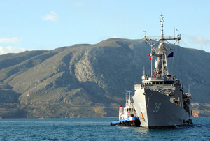 Uss Doyle (ffg 39) Is Assisted By Greek Tugs As She Arrives For A Brief Port Visit At Souda Bay. Image