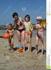 Kids Playing At The Beach Clipart Image