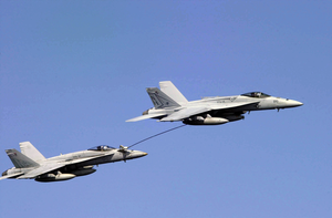 Two F/a-18 Hornets Perform Re-fueling Maneuvers While Passing Uss Nimitz (cvn 68) As Part Of An Air Show Demonstration During A Tiger Cruise Aboard The Ship Image