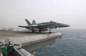 An F/a-18c Hornet Launches From One Of Four Steam-powered Catapults Aboard The Aircraft Carrier Uss Kitty Hawk (cv 63) Image