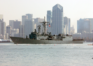Guided Missile Frigate Uss Thatch (ffg 43) Passes By The San Diego Skyline Image