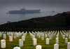 The Decommissioned  Constellation (cv 64) Is Towed Past Fort Rosecrans National Cemetery In Point Loma, Calif. Image