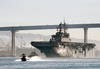 The Amphibious Assault Ship Passes Under The Coronado Bridge As She Makes Her Way Out Of The San Diego Bay Image