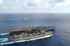 The Nuclear Powered Aircraft Carrier Uss Harry S. Truman (cvn 75) Conducts A Refueling At Sea (ras) With The Military Sealift Command (msc) Fast Combat Support Ship Usns Arctic (t-aoe 8). Image