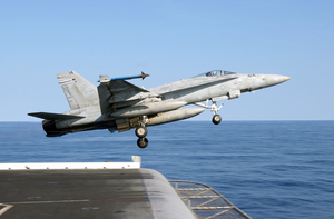 An F/a-18c Launches From One Of Four Steam-powered Catapults On The Ship S Flight Deck Image