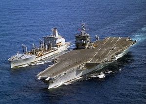 The Uss Enterprise (cvn 65) Steams Alongside The Military Sealift Command Fast Combat Support Ship Usns Leroy Grumman (aoe 195) During An Underway Replenishment (unrep) Image