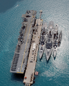 The Amphibious Assault Ship Uss Essex (lhd 2), And The Japanese Maritime Defense Force (jmsdf) Ships Shimakaze (ddg 172), Myoukou (ddg 175), Hamagiri (dd 155) And Natusio (ss 584) Pier-side Okinawa, Japan Image