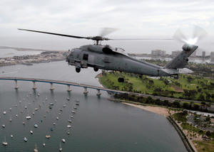 An Sh-60 Seahawk Flys Near Naval Amphibious Base Coronado Armed With An Agm-119 Image