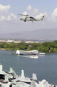 An Sh-60b Seahawk Assigned To The Indians Of Helicopter Anti-submarine Squadron Six (hs-6), Passes By The Uss Arizona Memorial While Entering Pearl Harbor, Hawaii. Image