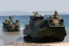 Amphibious Assault Vehicles (aav) Arrive On The Philippine Shore From The Amphibious Transport Dock Ship Uss Fort Mchenry (lsd 43) Clip Art