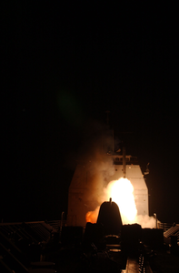 The First Tomahawk Land Attack Missile (tlam) Missile To Be Fired Into Iraq Is Launched From Aboard The Guided Missile Cruiser Uss Bunker Hill (cg 52) Image