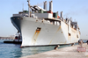 Tugboats Ease The Military Sealift Command (msc) Fast Sealift Ship Usns Bellatrix (t-akr 288) Into The Port Of Mina Ash-shu Image