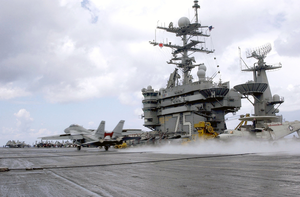 An F-14 Tomcat Fighter Catches The Arresting Wire On The Rain-soaked Flight Deck Aboard Uss Harry S. Truman (cvn 75) Image