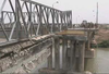 Seabees Assigned To Naval Mobile Construction Battalions (nmcb) Four And One Thirty-three Build A Bridge Over The Tigris River As Part Of The Humanitarian Assistance Phase Of Operation Iraqi Freedom Image