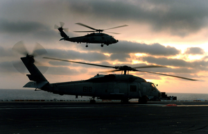 After An Sh-60f Seahawk Assigned To The Black Knights Of Helicopter Anti-submarine Squadron Four (hs-4) Lands, A Second Seahawk Comes In On Final Approach For The Flight Deck Aboard Uss John C. Stennis (cvn 74). Image