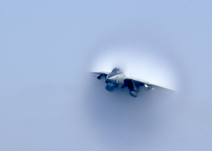 An F-14b Tomcat Assigned To The Swordsmen Of Fighter Squadron Thirty Seven (vf-32) Reaches The Sound Barrier During A Low Altitude Super Sonic Fly By. Image