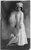 [woman Wearing Foot-lgth. Dress And Hat And Holding Umbrella With Tip On Floor.] Image