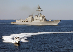 The Arleigh Burke-class Guided Missile Destroyer Uss Roosevelt (ddg 80) And A Small Boat Participate In A Simulated Small Boat Attack Exercise (swarmex) Image