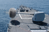 The Guided Missile Destroyer Uss John Paul Jones (ddg 53) Fires A Five-inch Round From A Mk-45 5-inch Gun (5 Inch 54 Cal.) During A Live-fire Exercise. Image
